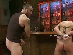 Strong muscled gay spanks his victim