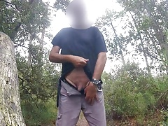 Pissing in the woods behind the beach