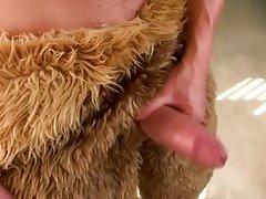 Pornstar in bear suit masturbating his thick cock
