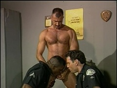 Three horny gay cops make love at their work place