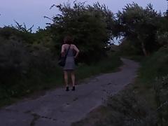 little girl is walking outside