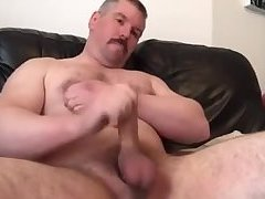 Meaty dilf tugs his balls and jerks off
