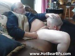 Bear sucks another