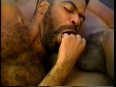 Black gay bear and his buddy satisfy each other with blowjobs