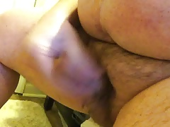 Fat man jerks stubby cock to completion