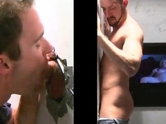 Bearded queer gets his dick sucked through a gloryhole