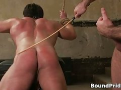 Bound dude gets gis ass whipped