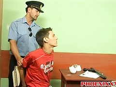 Police officer Roberts bangs hot twink Ian on a office desk