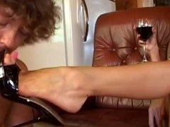 Slave cock teased while being used as a foot stool & cup holder