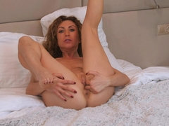 European housewife strips and plays with her pussy in bed