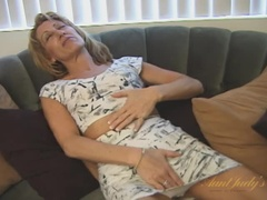 Small-breasted MILF Kat rubs herself down