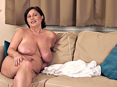 Big boobed mature has fun on couch