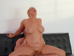 Short-haired mom with big tits fucks Seth in the living room