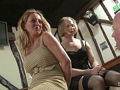 masochistic Lucy and friend spitting on slave