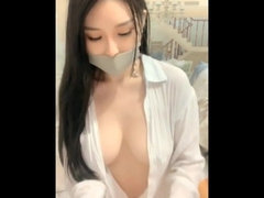 Young gagged Asian babe shows natural boobies on webcam