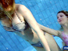 insane girls disrobe eachother in the pool