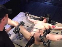 Back bent bigtitted brunette toyed in bondage