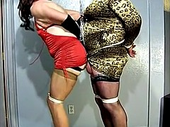 two crossdressing sluts tied together