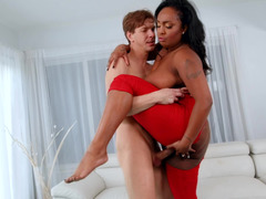 A big fat black chick is doing a lot of cock riding on the sofa