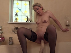 horny housewife shoving socks and a huge dildo up her pussy