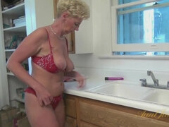 Blonde Grandma Aunt Taylor Lynn plays with Toy in the Kitchen
