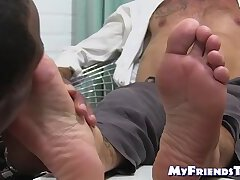 Black and white hunks enjoy a feet sucking session together