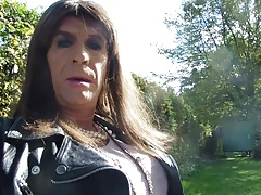 Tranny sitting on a parkbench masturbating her clitty