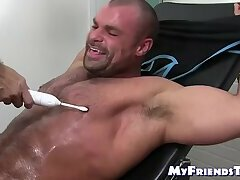 Huge muscular gay tickled while being bound by mature master