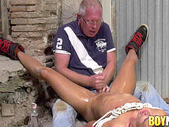 young trussed up fag receives an oily handjob by old perv