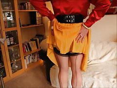 Red satin blouse and yellow pleats