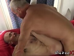 Old guy slides his cock in fit dudes mouth and barebacks him