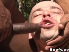 Wild gay guy sucking his boyfriend's big black cock in a forest