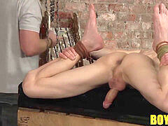 domineering tormentor Sebastian waxing Jonnys body rigid
