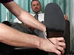 Handsome stud jerks off while having his bare feet worshiped