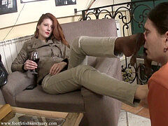 goddess Victoria gulps champagne and has her feet licked by a slave