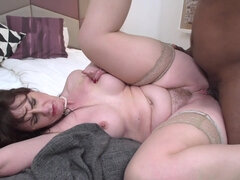 Mature bitch with black stud in interracial action