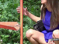 Czech chicks get caught pulling their trousers and peeing at a bus stop