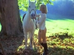 Brigitte Lahaie rides a horse to get to the sex place faster