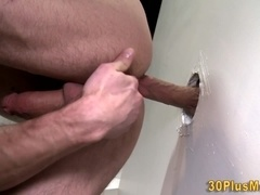 Dude blows gloryhole cock