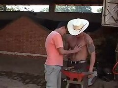 Slim boy fucks beefy cowboy