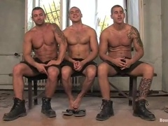 Three awesome hunks enjoy playing gay BDSM games indoors