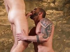 Zander Craze and Tyler Berg bareback and flip flop in a sensual basement setting